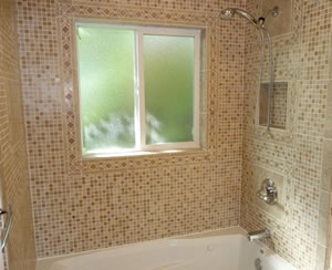 Bathroom Remodels include replacing fixtures, installing flooring, installing shelving, and installing tile